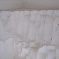 Pobiranje gašenega apna iz apnene jame